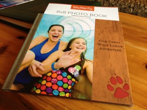 When you stay at a Great Wolf resort, you'll find a card in your room with a special code.  After your stay you can visit www.shutterfly.com/greatwolf, enter the code and upload photos from your trip. Shutterfly lays them out in a Great Wolf Lodge themed photo book and sends it to you.