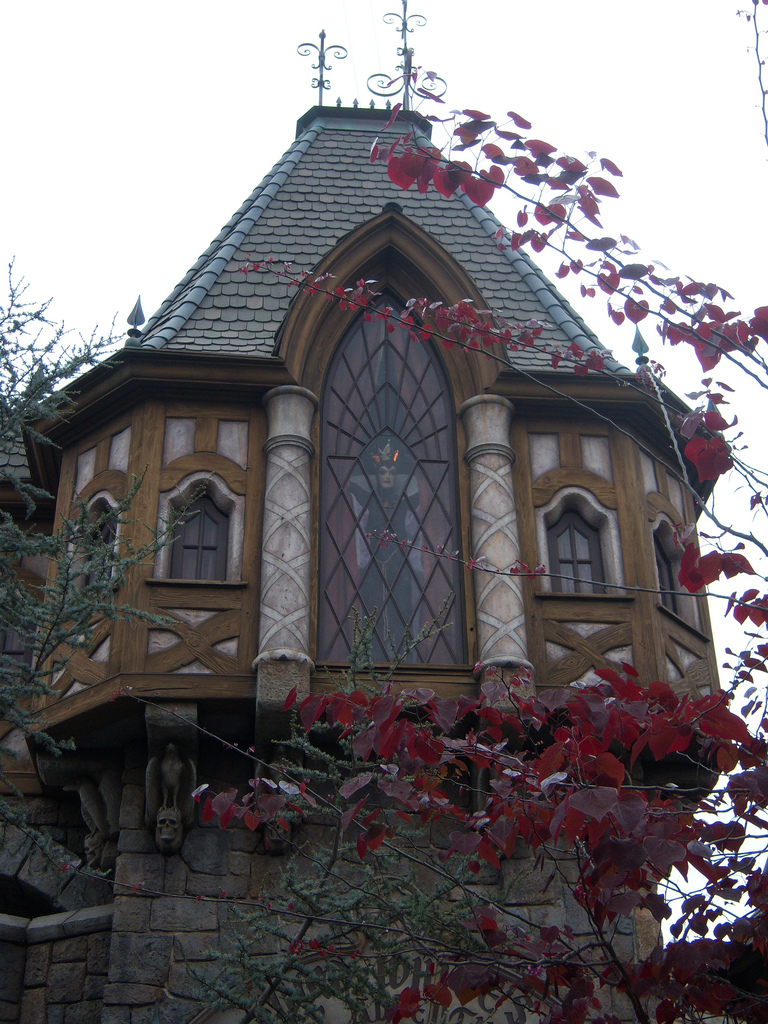 Snow White's Scary Adventures has another fun detail in the attraction's facade. If you look up through the trees, you'll see a large window with closed drapes. If you watch for a few moments, you'll see the curtains open and the Evil Queen peering down at you. This can best be seen when standing near the entrance to Peter Pan's Flight and looking across at the entrance to Snow White's Scary Adventures.